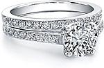 This image shows the setting with a 1.00ct round brilliant cut center diamond. The setting can be ordered to accommodate any shape/size diamond listed in the setting details section below. (Shown with matching wedding band- sold separately)