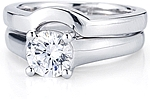 This image shows the setting with a 1.00ct round brilliant cut center diamond with the matching wedding band;Sold separately.