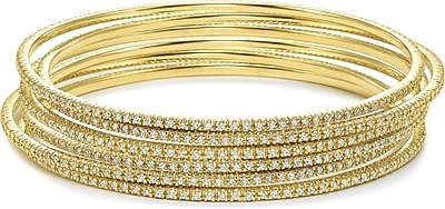 This picture shows six 14k yellow gold diamond bangles; Each sold separately.