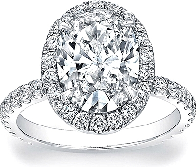 This image shows the ring made with a 2.75ct oval cut diamond. It can be made to accommodate and shape/size diamond listed in the diamond details section below.