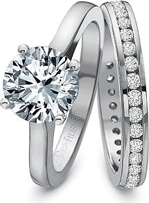 This image shows the setting with a 2ct round center diamond. The setting can be ordered to accommodate any shape/size diamond listed in the setting details section below. The matching wedding band is sold separately.