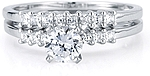 This image shows the setting with a 1.00ct round brilliant cut center diamond and the matching wedding band; sold separately.