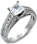 This image shows the setting with a .75ct princess cut diamond. The setting can be ordered to accommodate any shape/size diamond listed in the setting details section below.