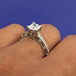 This image shows the ring with a .75ct princess cut center diamond.