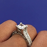 This image shows the setting with a 1.50ct princess cut center diamond.