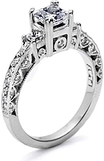 This image shows the setting with a 0.50ct princess cut center diamond. The setting can be ordered to accomodate any shape/size diamond listed in the setting details section below.
