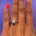 This image shows the small version set with a .75ct princess cut diamond.