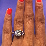 This image shows the medium version set with a 1.50ct round brilliant cut diamond.