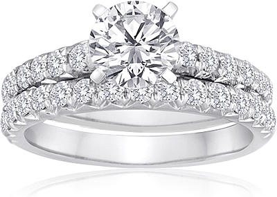 This image shows the setting with a 1.00ct round brilliant cut center diamond. The setting can be ordered to accommodate any shape/size diamond listed in the setting details section below. Wedding band sold separately.