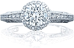 This image shows the ring with a .90ct round brilliant cut center diamond but can be ordered to accommodate any shape or size diamond listed below.
